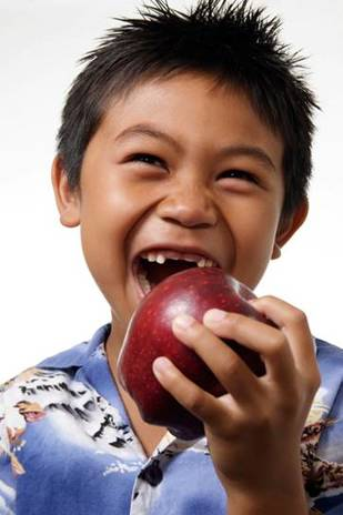 Young Boy About to Take a Big Bite Out of an Apple